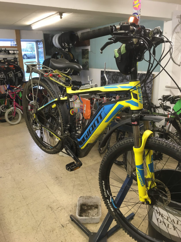 electric bike on workstand at new image bicycles